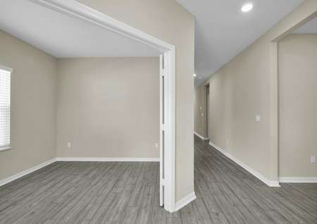 The entrance of the home leads to double doors, opening to a flex room that can be transformed into a home office or game room.