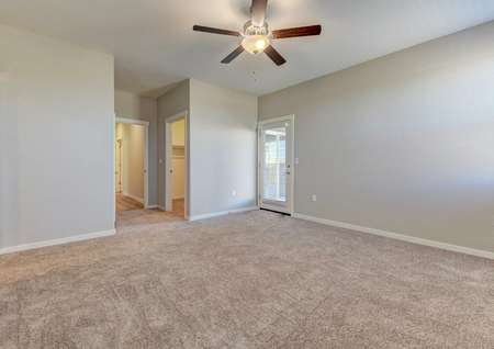 Cooley bedroom with ceiling fan, backyard door with window and blinds, and private bathroom