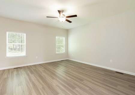 The Mid Atlantic Conway living room shown with vinyl wood looking floors and a decorative ceiling fan.