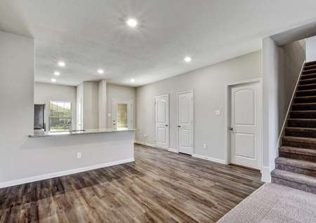 Victoria dining nook with wood styling floors, recessed lights, add large granite kitchen countertop