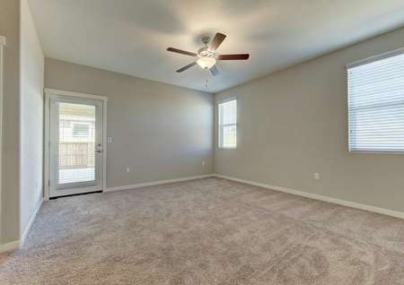 Cooley single-family home inside with light carpeting, white accent paint, and ceiling fan