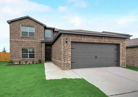 Oakmont 2 story single family home with brick siding, 2 car garage and landscaped front yard