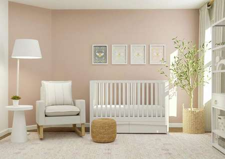 Rendering of a spacious bedroom decorated   as a nursery with a white crib, light-colored rocking chair, white shelving   and pink rug. The space has a window and accent wall painted pink.