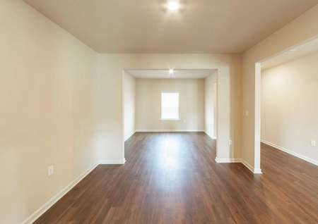 Spacious formal dining room and living room of the Hartwell floor plan