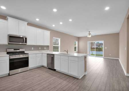 An open-concept floor plan allows for the kitchen to overlook the home's entertainment space.