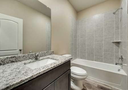 Secondary bath with tile in shower.