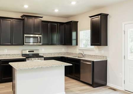 The Mid Atlantic Conway kitchen offering a different view of the kitchen island and dark brown cabinets.