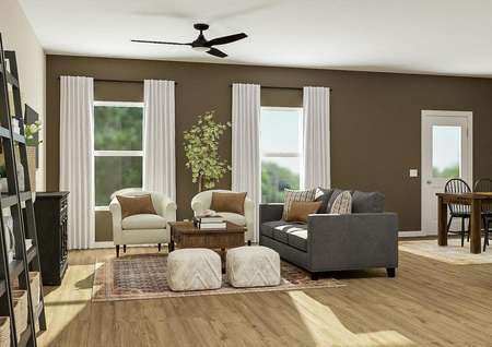 Rendering of the   open floor plan showcasing the living room with ceiling fan and two windows,   gray couch and two accent chairs, with the dining room and kitchen visible in   the back