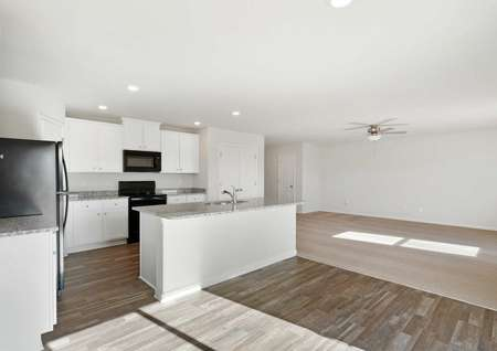 Avery great room with white finish kitchen, wood tile dining area, and carpeted living room