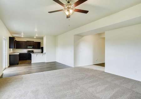 Mesa Verde great room with ceiling fan/light, carpet in living room, and tile floors in the dining area