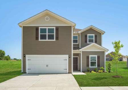 The Driftwood single family 2 story home is equipped with a white 2 car garage, light brown and tan siding, white trim, brown front door and shutters that match next to large windows