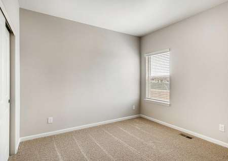 Spare bedroom with a single-windowandcarpet floors in the Pike floor plan.