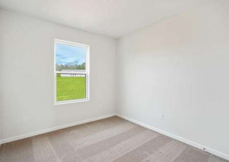 Anson bedroom with white window frame, off white walls, and tan carpet flooring