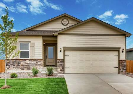 Arapaho finished exterior with landscaping, tan siding with dark brown trim, and two car garage