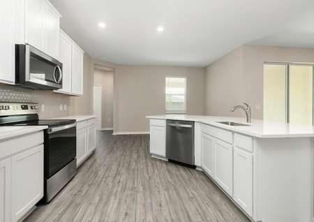 Open kitchen with quartz countertops and all new kitchen appliances.