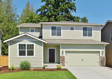 Exterior photo of the Henry plan by LGI Homes with pale green siding and water table stone at garage.