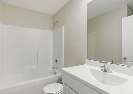 Allatoona home white bathroom with sink, toilet, and bath-shower