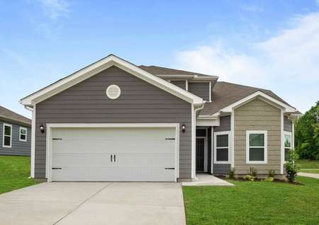 Exterior of the Cypress model home with grey siding, white trim, a white 2 car garage, and professional landscaped front yard