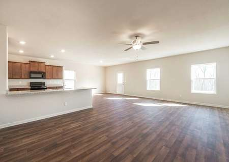 Lincoln great room with hardwood floors throughout, large granite countertop, and overhead ceiling fan