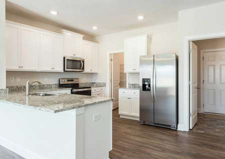 Allatoona kitchen with granite finish, stainless steel appliances, and white cabinetry
