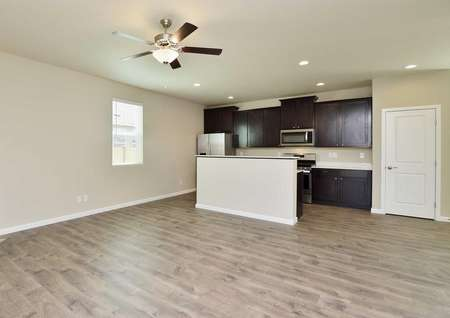 Fox great room with hardwood floors, wood cabinets in the kitchen, and overhead ceiling fan