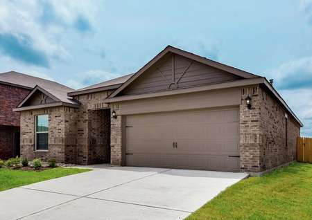 The Reed has a great curb appeal with a brick and siding exterior, attached garage and covered front entryway.