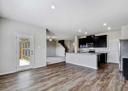 Shelby finished kitchen and dining nook with glass panel back door, gray walls with white trim, and recessed lighting