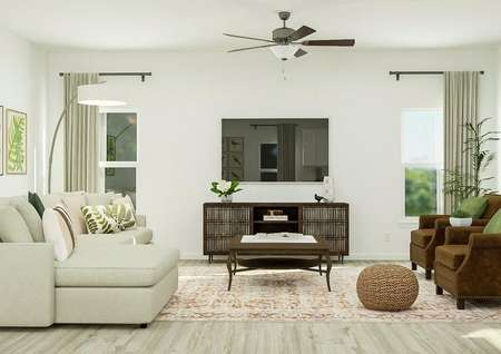 Rendering of the living room showing a   television and media cabinet centered between two windows. On one side of the   room is the large couch and opposite it are two armchairs.