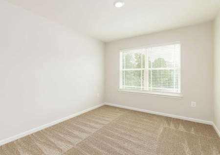 The Mid Atlantic Conway second bedroom shown carpeted and wood faux blinds.