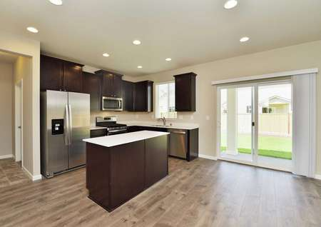 Henry kitchen with wood flooring, white countertops, and recessed lights