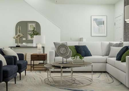 Rendering of living area with view   adjacent to staircase with round coffee table and side table.