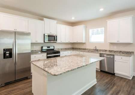 Jackson kitchen with granite countertops, wood floors, and white cabinetry