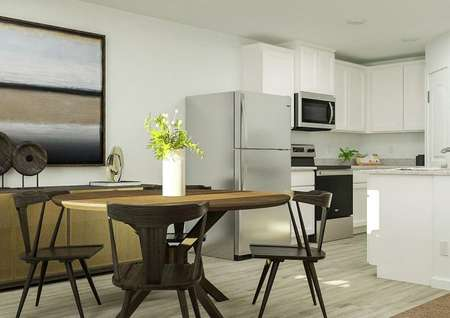 Rendering of kitchen area with round   table, large storage space and large artword above storage.