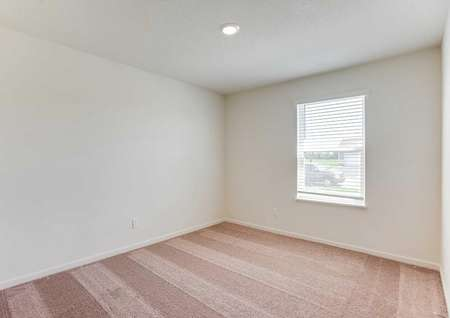 Chippewa bedroom with light brown carpets, white baseboards, and recessed lighting