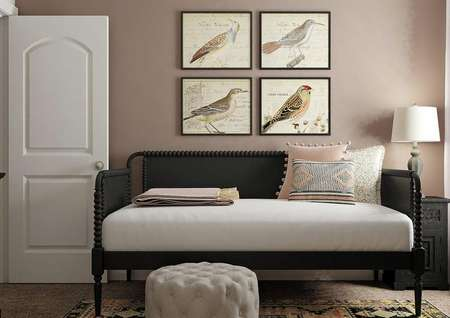 Rendering of secondary bedroom with a   window, carpet flooring, accent wall and black day bed.
