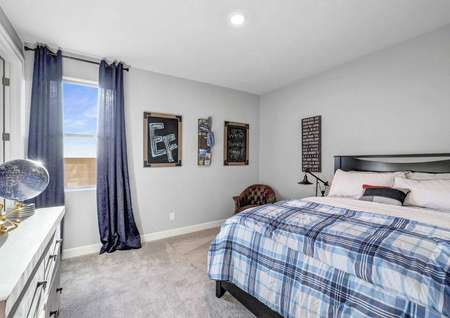 Mead bedroom with can light, blue draped window, and tan carpeting