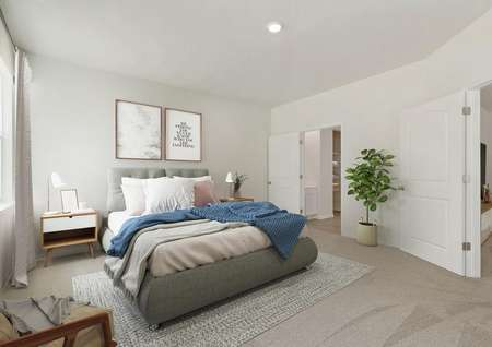 Staged master bedroom with bed, nightstands, window with drapes, chair and plant, view of door to attached bathroom.