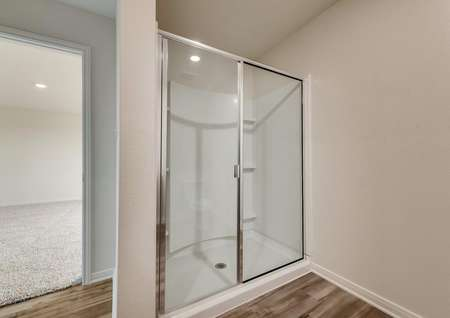 The master bath comes with an extended glass enclosed shower.