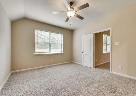 Erie bedroom with vaulted ceilings, ceiling fan with light, and brown carpeting
