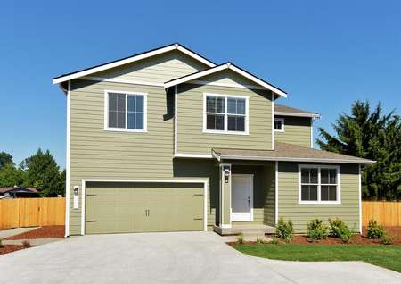 Exterior photo of the Mercer by LGI Homes with olive green siding, light trim and front yard landscaping.