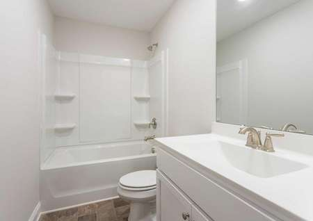 Hartford guest bath with modern fixtures, bath/shower combo, and white cabinets