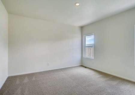 Arapaho bedroom with brown carpet, white on white paint, and recessed light