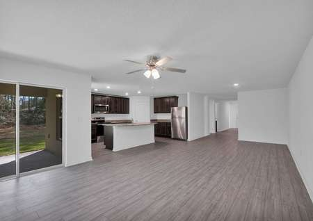 The family room leads to a chef-ready kitchen and even more entertainment space outdoors.