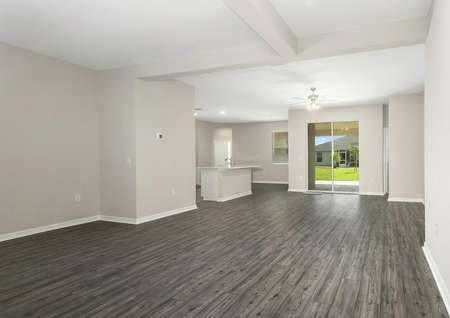 The home's foyer and dining room lead to the family room and covered back patio.