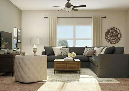 Rendering of living room with ceiling   fan, gray sectional couch, wooden coffee table, an accent chair and large   window