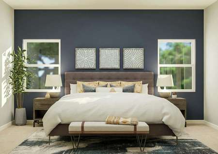 Rendering of the spacious master bedroom   with a large bed centered between two windows.