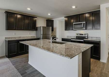 Stunning kitchen outfitted with designer upgrades such as stainless steel appliances and granite countertops.