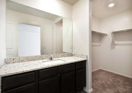 The Alamo floor plan master bath shown with a view into the walk in closet.