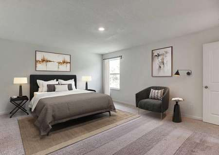 Staged serene master bedroom with queen bed, two nightstands with lamps, chair with art and wall lamp, one window near corner.