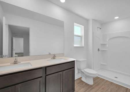 The master retreat features its own full bathroom with double sinks.